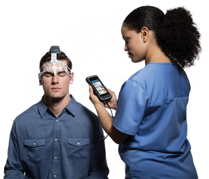 Patient being tested for concussion with BrainScope One - STAT MED Urgent Care